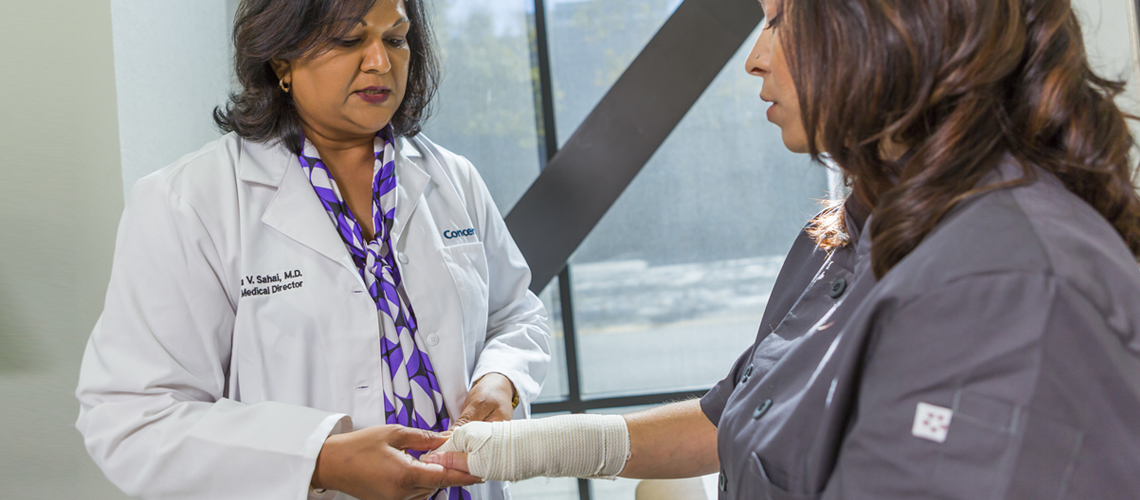 Emergency Medicine Physician Wrapped Wrist Exam