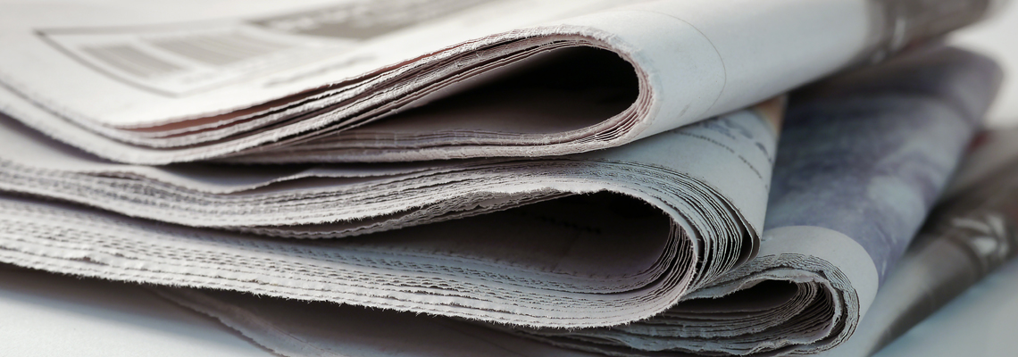 Closeup Of Folded Newspaper