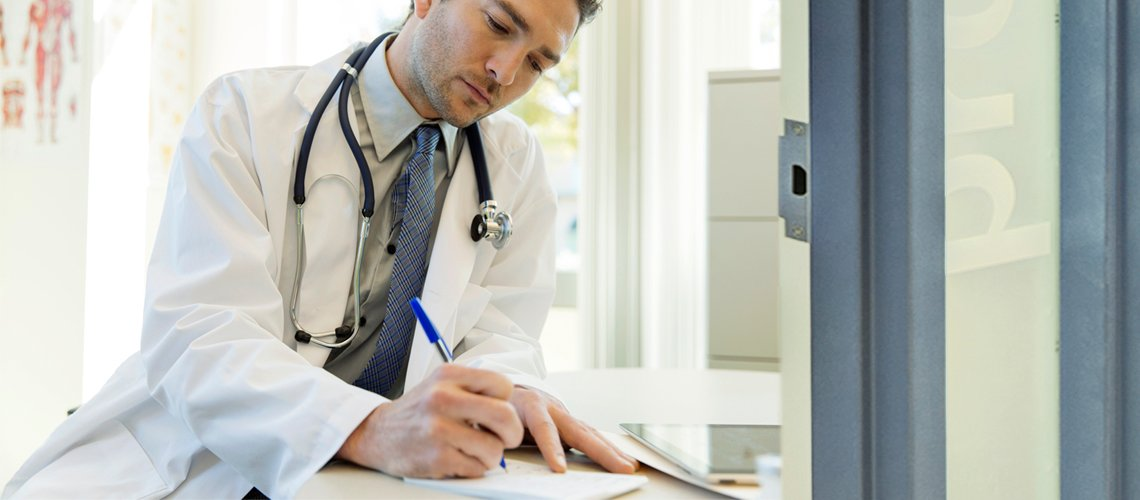 Urgent Care Physicians Doctor Writing Notes