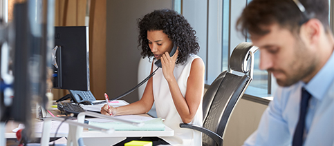 Corporate Position Woman At Desk On Phone