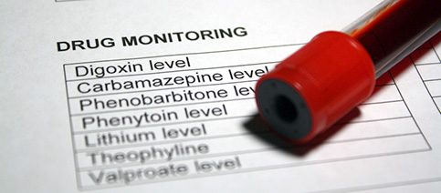 Image of different drug monitoring types with a pen on it.