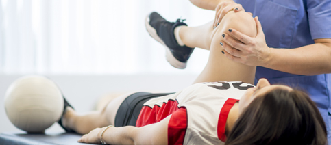 Elements of Sports Physical Boy Stretching Knee