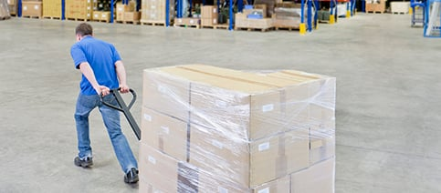 How An HPE Benefits You Man Pulling Pallet of Boxes