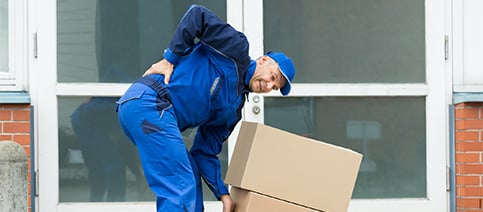 Scope Of Services Man Grabbing Boxes Holding Lower Back