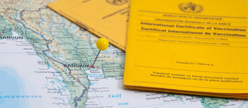 Map with a pin and passports for travel