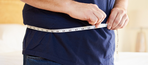What A Diagnostic Screening Includes Man measuring Waist