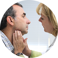 Patient getting throat checked by doctor
