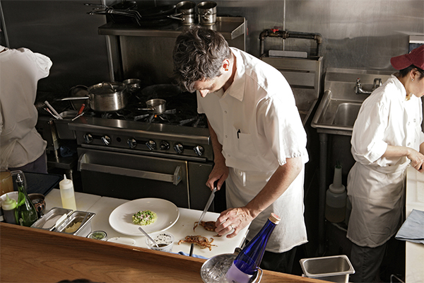 Drug testing services protect your employees. Here, a chef wields a knife.