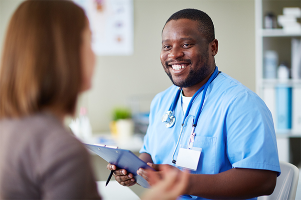Empathetic Medical Care Nurse Smiling at Patient