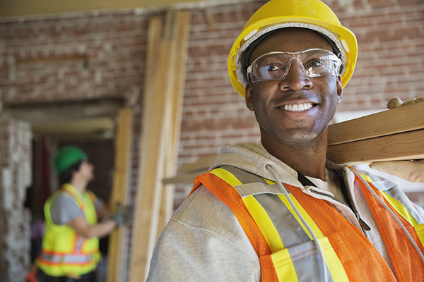How We Treat Man In Hard Hat Smiling