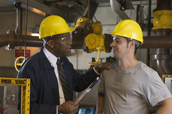 Industrial Athletes Two Men In Hard Hats Talking
