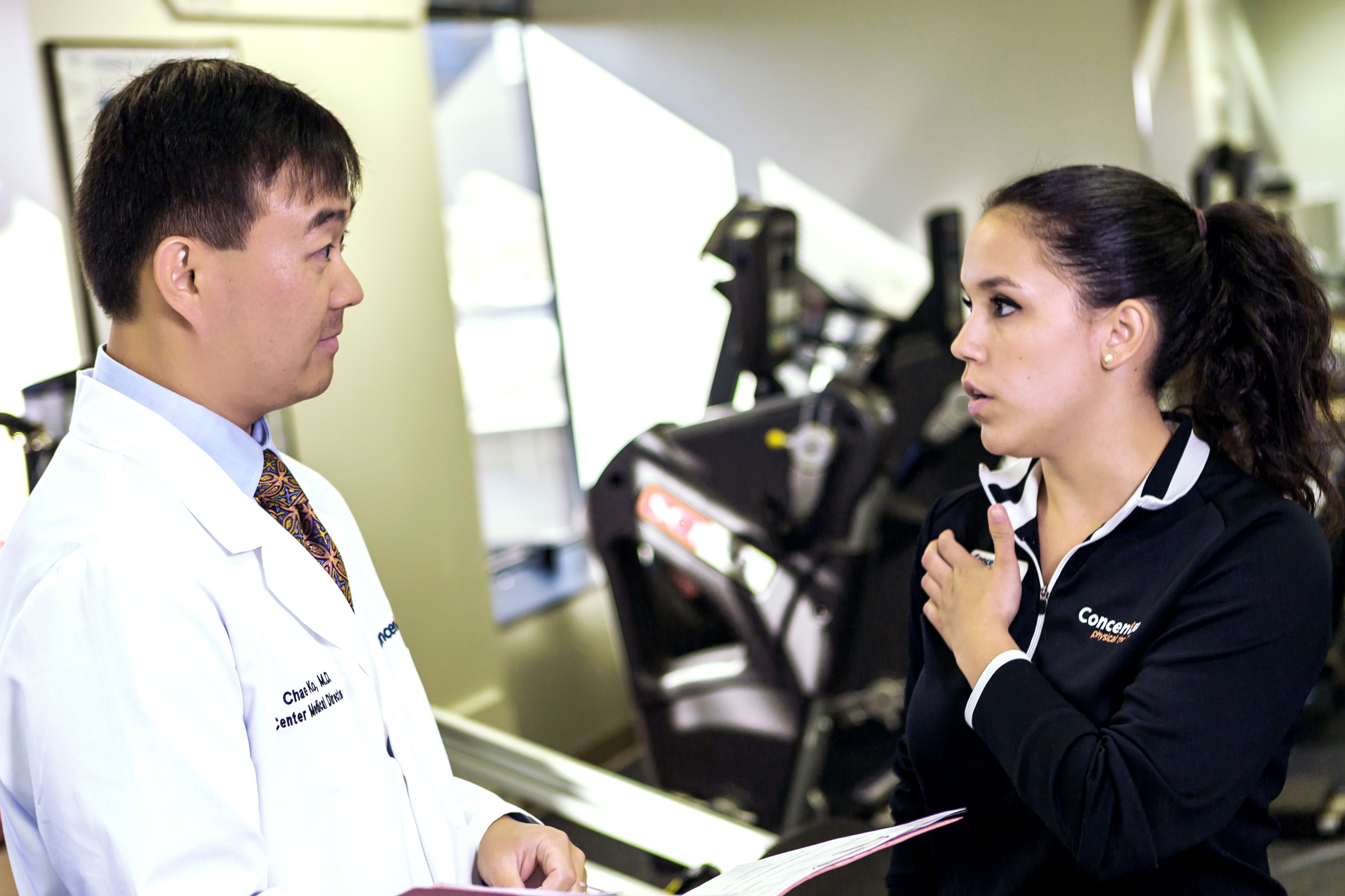 Occupational Medicine Doctor Talking to Trainer