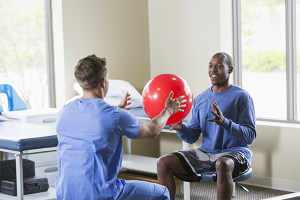 Post Injury Physicals Man With Therapy Ball