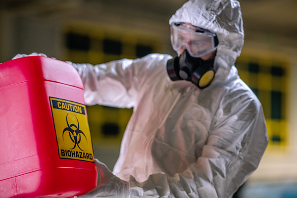 Man in hazmat suit working with hazardous chemicals