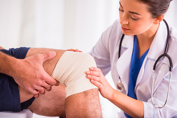 Treating Your Injuries Wrapped Knee Exam