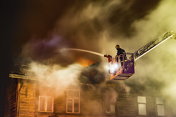 Firefighters putting out a roof fire who may need a physical