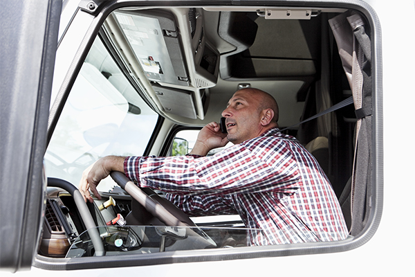 What It Means For Employers Man in Truck on Phone