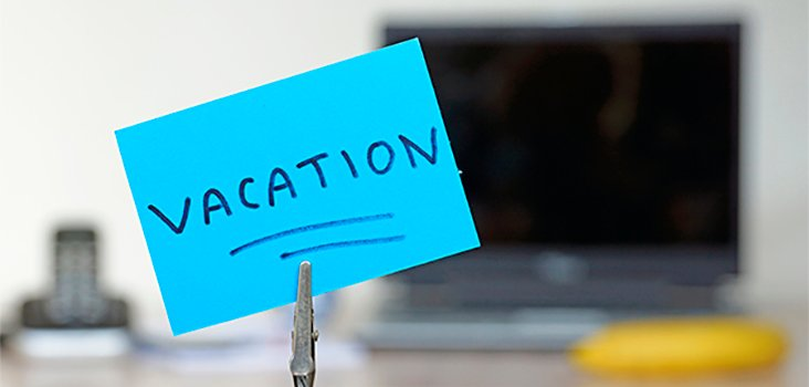 "Blue notecard that says ""vacation"" written on it"