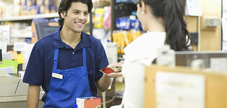 Male cashier assisting female customer