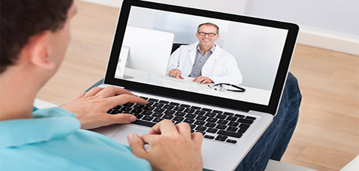 Man speaking to physician through videochat on tablet