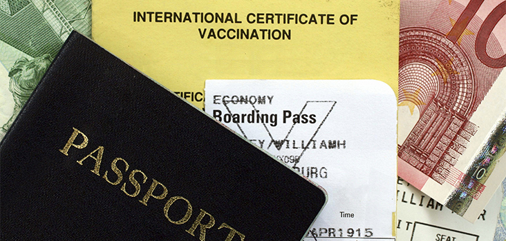 Passport and boarding pass with an international certification of vaccination