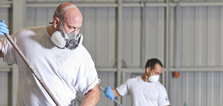 Man wearing respirator while working