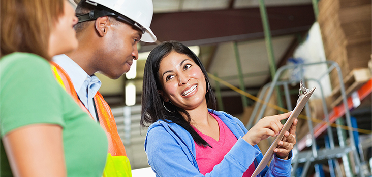 Female chatting with construction worker and another woman