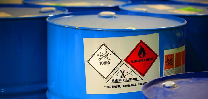 Barrels of chemicals representing why medical surveillance is needed for companies
